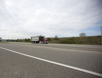 Dump Truck. Wide View of a Dump Truck on the Highway Stock Photo