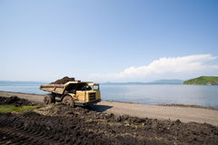 Dump truck on a background of the sea Stock Images