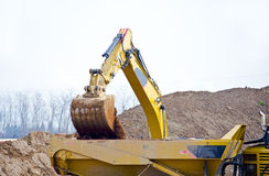 Dump truck and backhoe Stock Photos