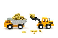 Dump truck and bulldozer Dealing with gold ore mine. On white background Stock Photography