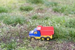 Dump truck children`s toy on the grass Royalty Free Stock Photos