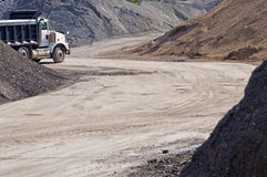 Dump Truck at Construction Gravel Pit. A white dump truck at a construction gravel pit Stock Image