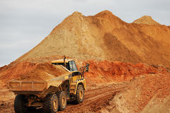 Dump truck in construction site. Dump truck moving dirt in construction site Stock Photo
