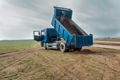 Dump truck in desert Royalty Free Stock Photography