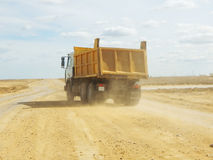 Dump truck on a dirt road. Stock Photos