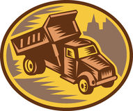 Dump truck done in retro woodcut style. vector illustration