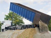 Dump truck downloading terrain. Big dump truck downloading terrain Stock Photo