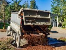 Dump Truck Dumping Load. Dump Truck Dropping Load of landscape bark royalty free stock photos