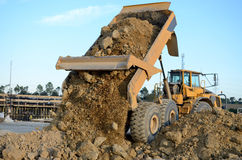 Dump truck. Dumping dirt and rocks Royalty Free Stock Photo