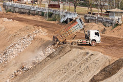 Dump truck is dumping rock. Royalty Free Stock Images