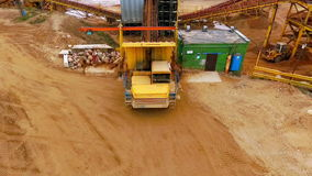 Dump truck dumping sand to conveyor. Sand sorting process on mining conveyor stock video