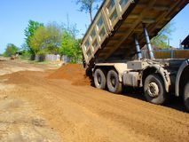 Dump truck earth stock image