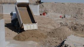 Dump truck emptying a load of dirt