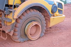 Dump truck with a flat tyre. On a construction site stock photography