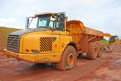 Dump truck with a flat tyre. On a construction site royalty free stock photo