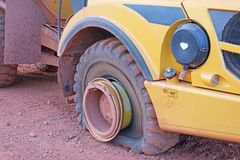 Dump truck with a flat tyre. On a construction site royalty free stock images