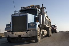 Dump truck front view. Dump trucks lined  up in a row Stock Image