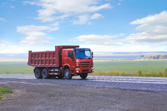 Dump truck goes on country highway Royalty Free Stock Photos