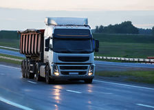 Dump truck goes on country highway Stock Photography