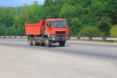 Dump truck goes on country highway. Big dump truck goes on country highway royalty free stock photo