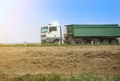 Dump truck goes on the country highway Royalty Free Stock Images