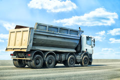 Dump truck goes on highway Stock Images