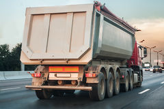 Dump truck goes on highway Stock Photography
