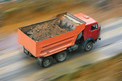 Dump truck goes on road. Dump truck loaded ground goes on road Stock Images