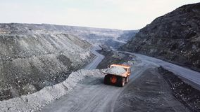 Free Dump Truck Is At Quarry. Top View Of Driving Orange Dump Truck With Rubble On Road Open Pit. Heavy Transport In Mining Royalty Free Stock Photos - 137771168