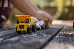 Dump Truck. The dump truck leads the line of construction cars as it prepares to dump out dirt stock photos