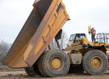 Dump truck and mechanic stock photography