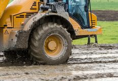 Dump Truck Mud. Front wheel of a dump truck driver through mud Stock Photo