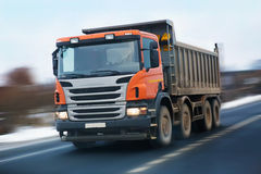 Dump truck with an orange cabin royalty free stock photo