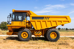 Dump truck. Parking big yellow transporter royalty free stock photos