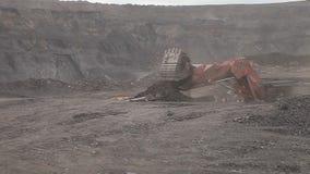 Dump truck passes by excavator  open pit. Dump truck passes by excavator  coal open pit stock footage