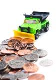 Dump truck plowing money Stock Images