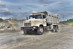 Dump truck. Poltava Region, Ukraine - June 26, 2010: Dump truck driving along the muddy road on the iron ore opencast stock image