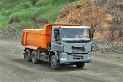Dump truck. Poltava Region, Ukraine - June 26, 2010: Dump truck driving to the loading site on the iron ore opencast stock photo