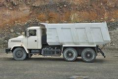 Dump truck. Poltava Region, Ukraine - June 26, 2010: Dump truck on the iron ore opencast - side view royalty free stock image