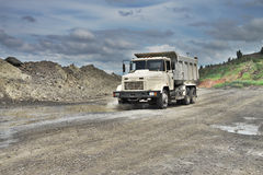 Dump truck. Poltava Region, Ukraine - June 26, 2010: white dump truck on the iron ore opencast Royalty Free Stock Images