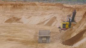 Dump Truck in sandy quarry. Loading Dump Truck in sandy quarry stock video