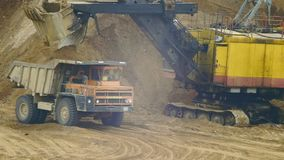 Dump Truck in sandy quarry. Loading Dump Truck in sandy quarry stock video footage