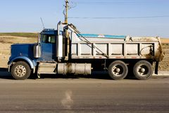 Dump truck side view. On site Royalty Free Stock Image