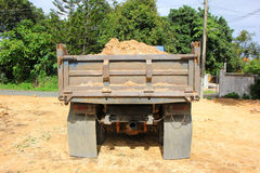 Dump truck of  soil at construction site. Old Dump truck of  soil at construction site Royalty Free Stock Photography