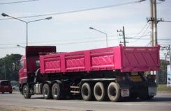 Dump truck of Thanachai Company. CHIANG MAI, THAILAND -JANUARY 8 2018: Trailer Dump truck of Thanachai Company. On road no.1001, 8 km from Chiangmai city stock images