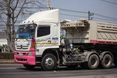 Dump truck of Thanachai Company. Chiangmai, Thailand - March 8 2019: Trailer Dump truck of Thanachai Company. On road no.1001, 8 km from Chiangmai city backhoe stock image