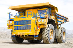 Dump truck. 220 tons, intendet for transportations of rock in mining conditions of deep plits Royalty Free Stock Images