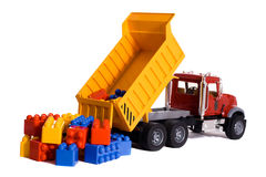 Dump truck toy. Downloading colorful blocks isolated on white Stock Photography