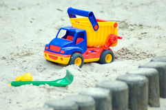 Dump truck - toy. Dump track in a sandbox Royalty Free Stock Photo