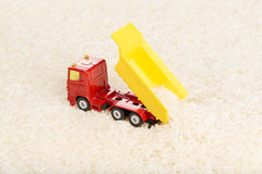 Dump truck toy unload rice grains Stock Image